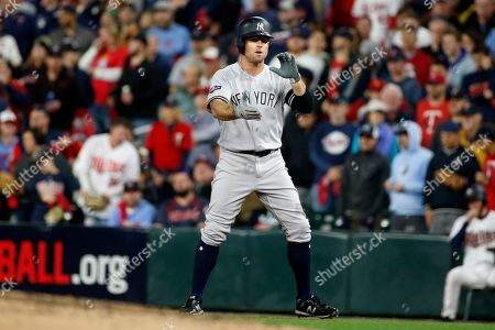 New York Yankees' Brett Gardner celebrates after hitting an RBI-single during the third inning in Game 3 of a baseball American League Division Series against the Minnesota Twins, in Minneapolis