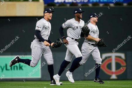 Aaron Judge, Cameron Maybin, Brett Gardner. New York Yankees' Aaron Judge, from left, Cameron Maybin and Brett Gardner celebrate after their team's 5-1 victory over the Minnesota Twins in Game 3 of a baseball American League Division Series, in Minneapolis