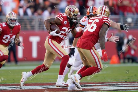 San Francisco 49ers cornerback Richard Sherman (25) returns an interception against the Cleveland Browns during the first half of an NFL football game in Santa Clara, Calif