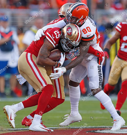 San Francisco 49ers cornerback Richard Sherman (L) intercepts a pass intended for Cleveland Browns wide receiver Jarvis Landry (R) during the first half of their NFL game at Levi's Stadium in Santa Clara, California, USA, 07 October 2019.