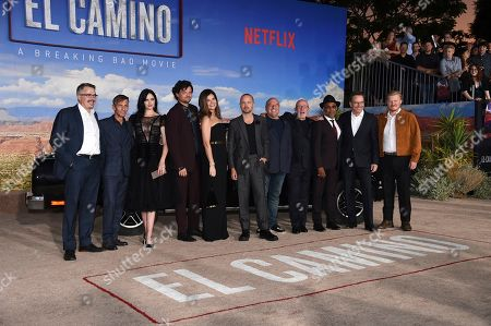 "Stock Photo of Vince Gilligan, Charles Baker, Krysten Ritter, Matt Jones, Betsy Brandt, Aaron Paul, Dean Norris, Jonathan Banks, Giancarlo Esposito, Bryan Cranston, Jesse Plemons. From left, Vince Gilligan, Charles Baker, Krysten Ritter, Matt Jones, Betsy Brandt, Aaron Paul, Dean Norris, Jonathan Banks, Giancarlo Esposito, Bryan Cranston and Jesse Plemons arrive at the Los Angeles premiere of ""El Camino: A Breaking Bad Movie,"" at the Regency Village Theatre, in Westwood, Calif"