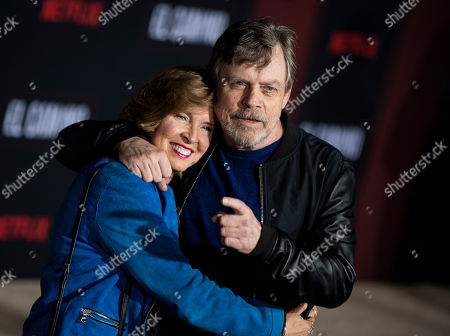 Mark Hamill (R) and his wife, Marilou York (L), pose for photographers as they arrive at the premiere of the Netflix production El Camino: A Breaking Bad Movie, at the Regency Village Theatre in Los Angeles, USA, 07 October 2019.