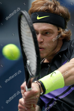Andrey Rublev, of Russia hits a return shot against Borna Coric of Croatia during their men's singles match at the Shanghai Masters tennis tournament at Qizhong Forest Sports City Tennis Center in Shanghai, China