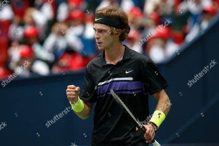 Andrey Rublev, of Russia reacts while playing against Borna Coric of Croatia in their men's singles match at the Shanghai Masters tennis tournament at Qizhong Forest Sports City Tennis Center in Shanghai, China