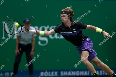 Andrey Rublev, of Russia reaches for the ball as he plays against Borna Coric of Croatia in their men's singles match at the Shanghai Masters tennis tournament at Qizhong Forest Sports City Tennis Center in Shanghai, China