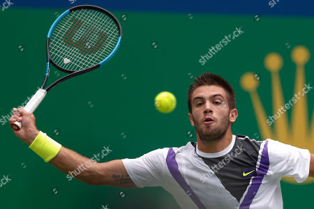 Borna Coric of Croatia reaches for the ball as he plays against Andrey Rublev, of Russia in their men's singles match at the Shanghai Masters tennis tournament at Qizhong Forest Sports City Tennis Center in Shanghai, China