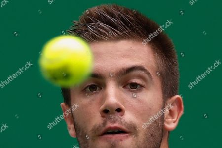 Borna Coric of Croatia eyes on the ball as he plays against Andrey Rublev, of Russia in their men's singles match at the Shanghai Masters tennis tournament at Qizhong Forest Sports City Tennis Center in Shanghai, China