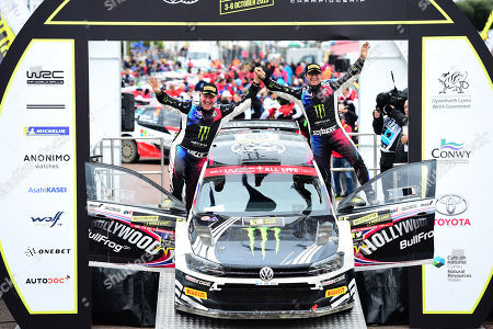 Wales Rally GB 2019 Podium: Petter Solberg & Co Driver Phil MILLS competing in the Volkswagen Polo R5 celebrate with fans after competing in their final Rally GB
