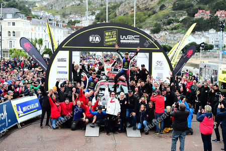 Stock Image of Wales Rally GB 2019 Podium: Petter Solberg & Co Driver Phil MILLS competing in the Volkswagen Polo R5 celebrate with friends, family and the team after competing in their final Rally GB