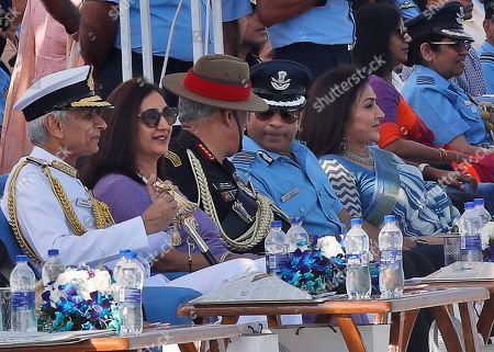 Former Indian cricketer and honorary Indian Air Force (IAF) officer Sachin Tendulkar, center right, speaks with Indian Army chief General Bipin Rawat during Air Force Day parade at the Hindon air base on the outskirts of New Delhi, India . Air Force Day is celebrated to mark the day the Indian air force, the fourth largest air force in the world, was officially established in 1932. Apart from defending Indian air space, the air force also delivers humanitarian aid and disaster relief material during natural calamities