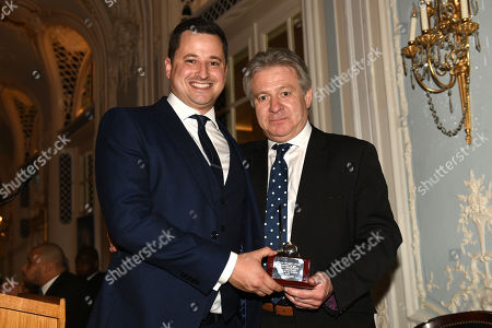 Stock Photo of General secretary of the BBBofC Robert Smith (R) is presented with an award by Andy Scott during the Boxing Writers Club Annual Dinner at the Savoy Hotel on 7th October 2019