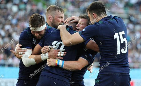 Adam Hastings - Scotland fly half celebrates his first half try with (L to R) Ryan Wilson, John Barclay, George Horne and Blair Kinghorn.