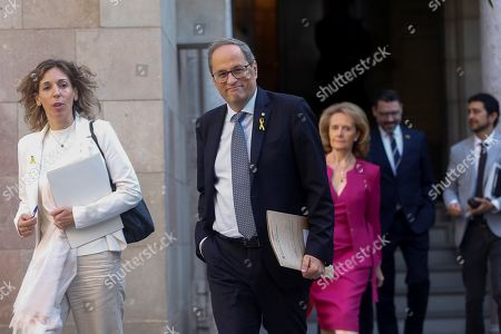 Catalan regional President, Joaquim Torra (C), smiles upon his arrival, accompanied by Catalan regional Business Minister, Angels Chacon (L), to the weekly Catalan government's meeting in Barcelona, Catalonia, northeastern Spain, 08 October 2019. The meeting is hold a day after the Catalan Parliament rejected a non-confidence motion against Torra filed by pro-Spain Ciudadanos (Citizens) party.