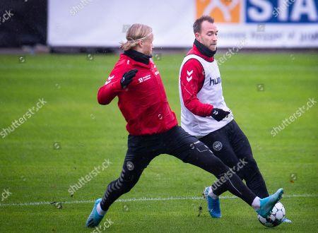Denmark's Kasper Dolberg, left, and Christian Eriksen, right, during a traning session in Elsingoer, Tuesday, October 8, 2019. Denmark will host Switzerland in group B Saturday.