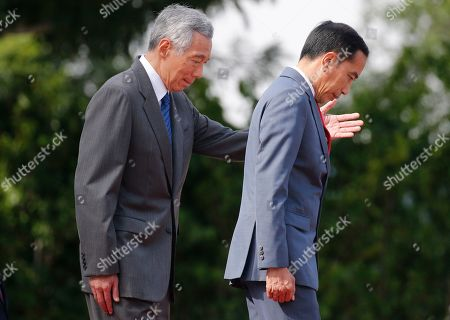 Singapore Prime Minister Lee Hsien Loong (L) ushers Indonesian President Joko Widodo (R) during a welcome ceremony at the Istana Presidential Palace in Singapore, 08 October 2019. Widodo, known affectionately as Joko Widodo, is on a a two-day visit to Singapore for the Singapore-Indonesia Leaders' Retreat.