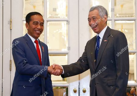 Indonesian President Joko Widodo (L) and Singapore Prime Minister Lee Hsien Loong (R) shake hands at the Istana Presidential Palace in Singapore, 08 October 2019. Widodo, known affectionately as Joko Widodo, is on a a two-day visit to Singapore for the Singapore-Indonesia Leaders' Retreat.