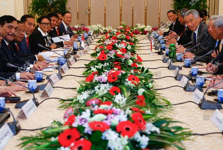 Stock Photo of Indonesian President Joko Widodo (3-L) and Singapore Prime Minister Lee Hsien Loong (3-R) are seen during a delegation meeting at the Istana Presidential Palace in Singapore, 08 October 2019. Widodo, known affectionately as Joko Widodo, is on a a two-day visit to Singapore for the Singapore-Indonesia Leaders' Retreat.
