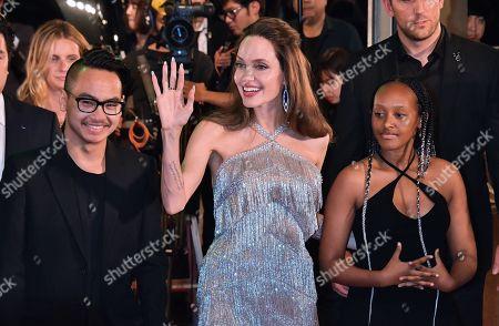 (L-R) Maddox Jolie-Pitt, Angelina Jolie and Zahara Jolie-Pitt