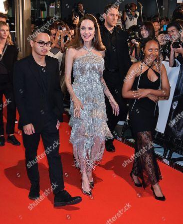 Stock Image of (L-R) Maddox Jolie-Pitt, Angelina Jolie and Zahara Jolie-Pitt
