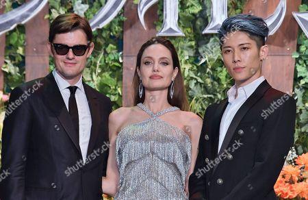 Stock Image of (L-R) Sam Riley, Angelina Jolie and Japanese guitarist Miyavi