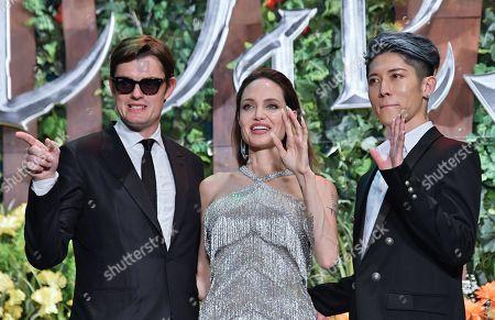 Stock Picture of (L-R) Sam Riley, Angelina Jolie and Japanese guitarist Miyavi