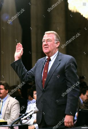 United States Attorney General Edwin Meese, III is sworn-in to testify before the US House Select Committee to Investigate Covert Arms Transactions with Iran / US Senate Select Committee on Secret Military Assistance to Iran and the Nicaraguan Opposition (Iran/Contra Committee) on Capitol Hill in Washington, DC.
