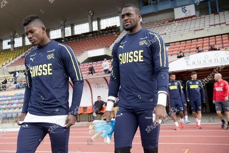 Switzerland's national soccer team player Breel Embolo, left, and goalkeeper Yvon Mvogo, right, arrive for a training session before the upcoming UEFA Euro 2020 qualifying soccer matchs, at the Stade Olympique de la Pontaise in Lausanne, Switzerland, Tuesday, October 8, 2019. Denemark will play Switzerland for the UEFA Euro 2020 qualifying Group D soccer match on October 12 in Copenhagen.