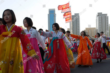 Stock Image of Students celebrate in public dances the 22nd anniversary of Chairman Kim Jong Il's election as general secretary of the Workers' Party of Korea (WPK) in front of the Pyongyang Indoor Stadium in Pyongyang, North Korea