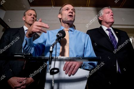 Stock Image of Scott Perry, Jim Jordan, Mark Meadows. Republican lawmakers, from left, Rep. Scott Perry, R-Pa., Rep. Jim Jordan, R-Ohio, ranking member of the Committee on Oversight Reform, and Rep. Mark Meadows, R-N.C., speak to reporters after a formerly planned joint committee deposition with Ambassador Gordon Sondland, with the transcript to be part of the impeachment inquiry into President Donald Trump, was canceled by order of the Trump Administration, on Capitol Hill in Washington, . T