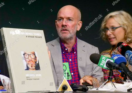 Michael Stipe, Giovanna Melandri. Composer and singer Michael Stipe, left, flanked by MAXXI Foundation President Giovanna Melandri, answers questions during a press conference held to present his latest book 'Our Interference Times: a visual record' at the MAXXI modern art museum in Rome