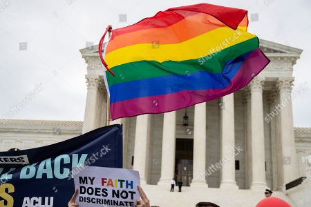 Supporters of the LGBT wave their flag in front of the U.S. Supreme Court, in Washington. The Supreme Court is set to hear arguments in its first cases on LGBT rights since the retirement of Justice Anthony Kennedy. Kennedy was a voice for gay rights while his successor, Brett Kavanaugh, is regarded as more conservative