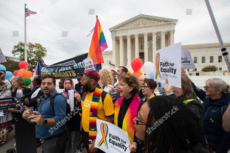 Supporters of the LGBT gather in front of the U.S. Supreme Court, in Washington. The Supreme Court is set to hear arguments in its first cases on LGBT rights since the retirement of Justice Anthony Kennedy. Kennedy was a voice for gay rights while his successor, Brett Kavanaugh, is regarded as more conservative