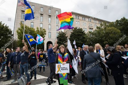 Supporters of the LGBT gather near the U.S. Supreme Court, in Washington. The Supreme Court is set to hear arguments in its first cases on LGBT rights since the retirement of Justice Anthony Kennedy. Kennedy was a voice for gay rights while his successor, Brett Kavanaugh, is regarded as more conservative
