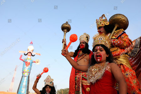 Indian devotees dressed as Hindu monkey God Hanuman shout slogans as they stand in front of the effigy of demon king Ravana during Dussehra festival celebrations in Jammu, the winter capital of Kashmir, India, 08 October 2019. Dussehra is an annual Hindu religious festival which follows the nine-day festival of Navratri and is celebrated as the victory of the mythological Hindu God Lord Rama over the evil demon king Ravana.