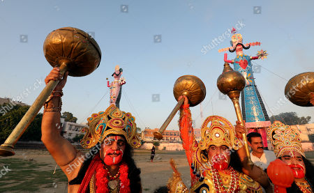Indian devotees dressed as Hindu monkey God Hanuman shout slogans as they stand in front of an effigy of demon king Ravana during Dussehra festival celebrations in Jammu, the winter capital of Kashmir, India, 08 October 2019. Dussehra is an annual Hindu religious festival which follows the nine-day festival of Navratri and is celebrated as the victory of the mythological Hindu God Lord Rama over the evil demon king Ravana.