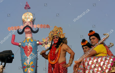 Indian devotees dressed as Hindu monkey God Hanuman, Lord Rama (C) and his younger brother Lakshman (L) stand in front of an effigy of demon king Ravana during Dussehra festival celebrations in Jammu, the winter capital of Kashmir, India, 08 October 2019. Dussehra is an annual Hindu religious festival which follows the nine-day festival of Navratri and is celebrated as the victory of the mythological Hindu God Lord Rama over the evil demon king Ravana.