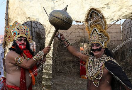 Indian devotees dressed as Hindu monkey God Hanuman (L) and a demon take part in a mock fight during Dussehra festival celebrations in Jammu, the winter capital of Kashmir, India, 08 October 2019. Dussehra is an annual Hindu religious festival which follows the nine-day festival of Navratri and is celebrated as the victory of the mythological Hindu God Lord Rama over the evil demon king Ravana.