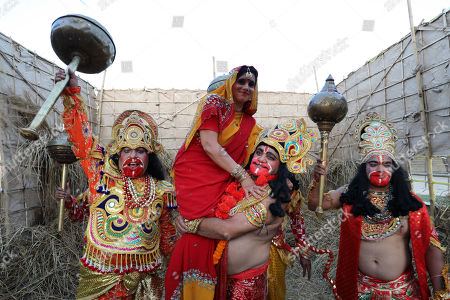 Indian devotees dressed as Hindu monkey god Hanuman (C) carries an artist dressed as Hindu deity, Sita, the wife of Hindu god, Lord Rama during the Dussehra festival celebrations in Jammu, the winter capital of Kashmir, India, 08 October 2019. Dussehra is an annual Hindu religious festival which follows the nine-day festival of Navratri and is celebrated as the victory of the mythological Hindu God Lord Rama over the evil demon king Ravana.
