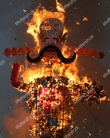 An effigy of demon king Ravana burns during the Dussehra festival celebrations in Jammu, the winter capital of Kashmir, India, 08 October 2019.Dussehra is an annual Hindu religious festival which follows the nine-day festival of Navratri and is celebrated as the victory of the mythological Hindu God Lord Rama over the evil demon king Ravana.