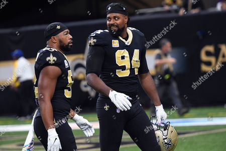 New Orleans Saints defensive end Cameron Jordan (94) smiles as he walks ti the sideline in the first half of an NFL football game against the Tampa Bay Buccaneers in New Orleans