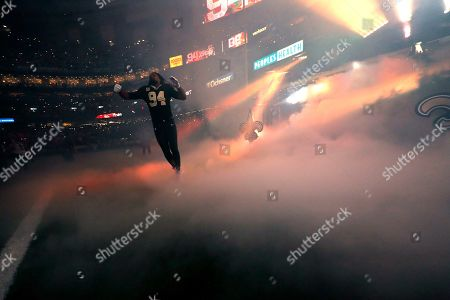 New Orleans Saints defensive end Cameron Jordan (94) takes to the field during player introductions as part of pre-game festivities in the first half of an NFL football game in New Orleans