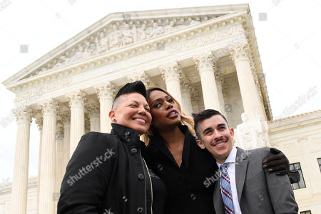 Stock Photo of Chase Strangio, Laverne Cox, Sara Ramirez. Grey's Anatomy' star Sara Ramirez, left, Laverne Cox, the award-winning transgender actress and longtime trans rights activist, center, and Chase Strangio, an attorney with the American Civil Liberties Union who argued the Harris Funeral Homes case before the Supreme Court, pose for a photo outside the Supreme Court in Washington