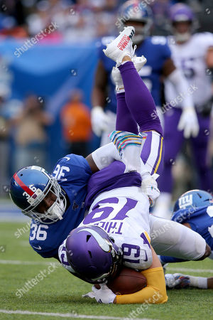 Adam Thielen, Sean Chandler. Minnesota Vikings wide receiver Adam Thielen (19) in action against New York Giants safety Sean Chandler (36) during an NFL football game on in East Rutherford, N.J. The Vikings defeated the Giants 28-10