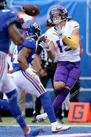 Minnesota Vikings wide receiver Adam Thielen (19) catches a touchdown pass against New York Giants cornerback Grant Haley (34) during an NFL football game on in East Rutherford, N.J. The Vikings defeated the Giants 28-10