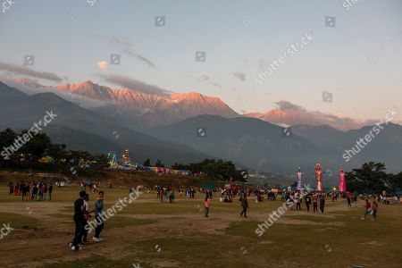 Effigies of mythological demon king Ravana, center, his brother and his son are seen against a backdrop of the Dhauladhar mountains before they are burnt, marking the end of Dussehra festival in Dharmsala, India, . Dussehra commemorates the triumph of Lord Rama over the demon king Ravana, marking the victory of good over evil