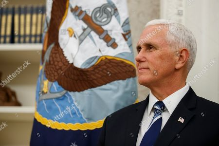Vice President Mike Pence stands during a ceremony to present the Presidential Medal of Freedom to former Attorney General Edwin Meese, in the Oval Office of the White House, in Washington