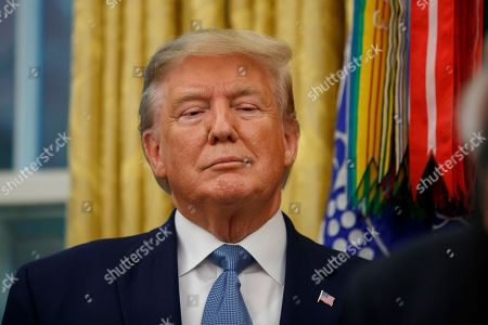 President Donald Trump stands during a ceremony to present the Presidential Medal of Freedom to former Attorney General Edwin Meese, in the Oval Office of the White House, in Washington
