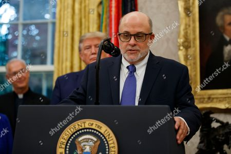 Mark Levin speaks, with President Donald Trump behind him, during a ceremony to present the Presidential Medal of Freedom to former Attorney General Edwin Meese, in the Oval Office of the White House, in Washington