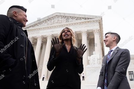 Stock Picture of Mexican-American actress Sara Ramirez (L), US actress Laverne Cox (C) and transgender activist and attorney Chase Strangio (R); a member of the legal team representing the plaintiff in the case R.G. and G.R. Harris Funeral Homes Inc. versus Equal Employment Opportunity Commission (EEOC); stand together outside the Supreme Court after the court heard oral arguments in three cases, in Washington, DC, USA, 08 October 2019. The Supreme Court heard oral arguments for three cases, 08 October, two of which involve allegations of discrimination based on sexual orientation and a case on whether discrimination laws apply to transgender workers. The cases are Bostock versus Clayton County, Georgia; Altitude Express Inc. versus Zardal; and R.G. and G.R. Harris Funeral Homes versus EEOC.