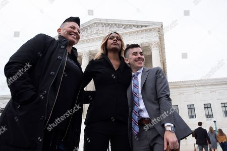 Mexican-American actress Sara Ramirez (L), US actress Laverne Cox (C) and transgender activist and attorney Chase Strangio (R); a member of the legal team representing the plaintiff in the case R.G. and G.R. Harris Funeral Homes Inc. versus Equal Employment Opportunity Commission (EEOC); stand together outside the Supreme Court after the court heard oral arguments in three cases, in Washington, DC, USA, 08 October 2019. The Supreme Court heard oral arguments for three cases, 08 October, two of which involve allegations of discrimination based on sexual orientation and a case on whether discrimination laws apply to transgender workers. The cases are Bostock versus Clayton County, Georgia; Altitude Express Inc. versus Zardal; and R.G. and G.R. Harris Funeral Homes versus EEOC.